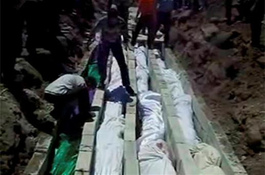 Bodies of Syrians killed one day earlier being made ready for a mass funeral in Houla