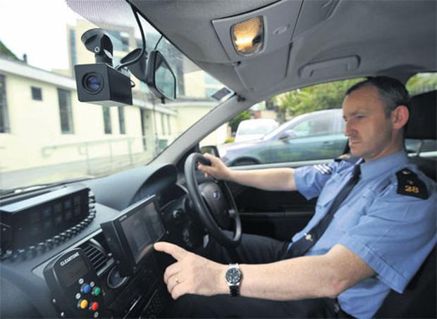 Sergeant Danny Rice operates the Automated Number Plate Recognition camera.