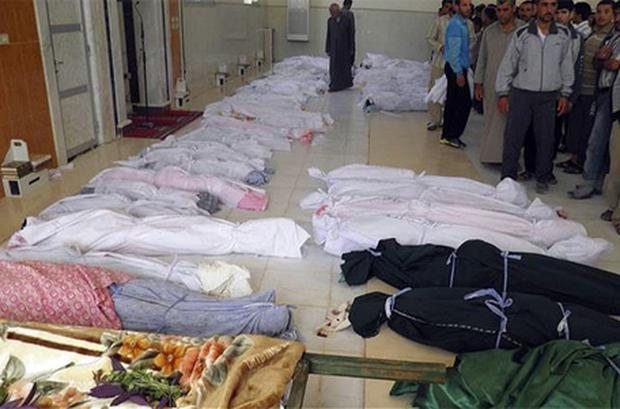 Shrouded dead bodies after a Syrian government assault on Houla, Syria. Photo: AP