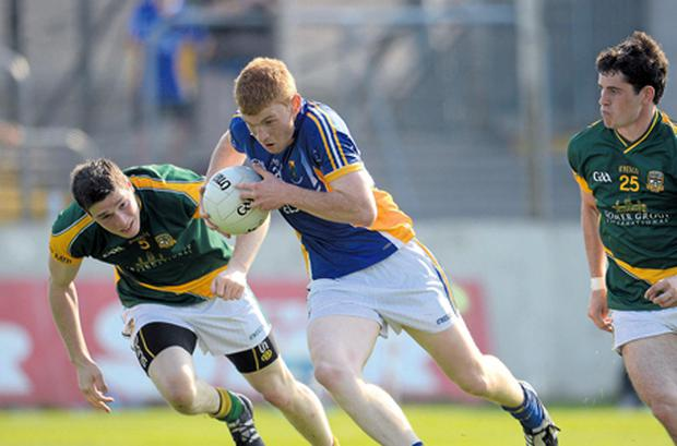 Wicklow's Peadar Burke tries to get past Donnacha Tobin and Donal Keogan at Dr Cullen Park