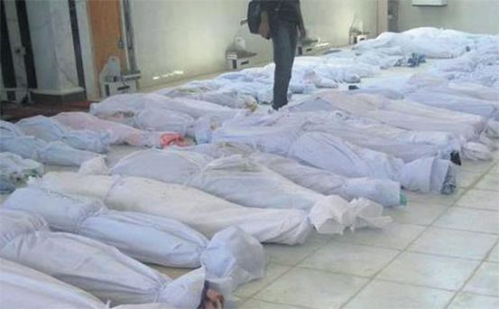 The bodies of some of the adults and children who anti-government protesters say were killed by government security forces.