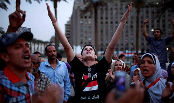 Protesters shout slogans during a protest against candidate Ahmed Shafiq at Tahrir Square in Cairo. Photo: Reuters