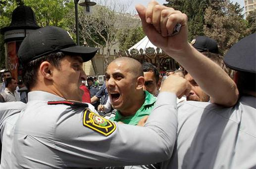 Opposition supporters scuffle with police during an anti-government protest in central Baku. Photo: Reuters