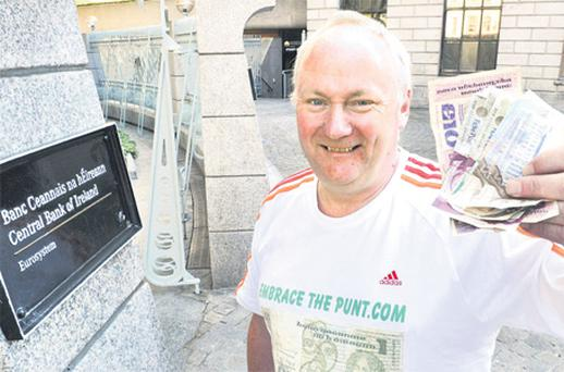 Businessman Tony Morgan, who began the 'Embrace The Punt' scheme in Clones, Co Monaghan, outside the Central Bank in Dublin with his first consignment of the old notes