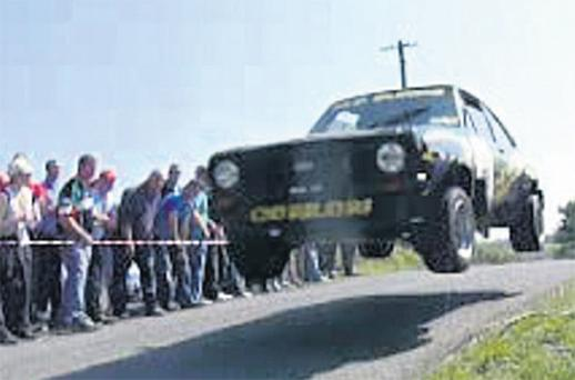 The car driven by Michael Conlon can be seen speeding over the crest of a hill