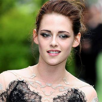Twilight star Kristen Stewart has admitted she had a hard time growing up in the public eye. Photo: PA