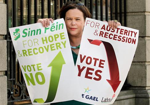 Sinn Fein's Mary Lou McDonald pictured outside Leinster House with a Sinn Fein Poster Calling for a NO Vote and a Fine Gael/Labour [ calling for a yes vote]in the upcoming Fiscal Treaty Referendum. Photo: Frank McGrath