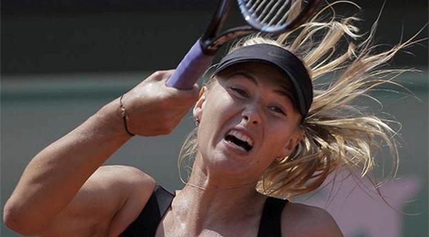 Maria Sharapova in action against Alexandra Cadantu. Photo: AP