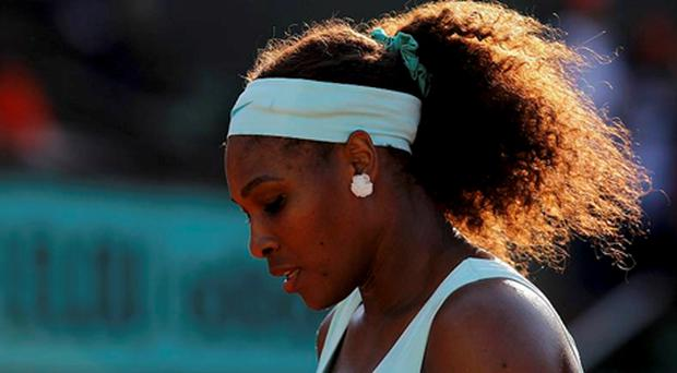 Serena Williams reacts during her match against Virginie Razzano. Photo: Reuters