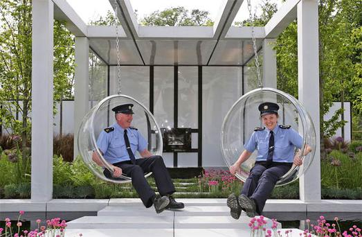 Gardai, Barry Heffernan and Pauline Firth try out one on the exhibits for 2012 Bloom Show