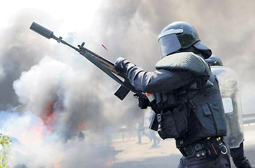 Civil Guards firing plastic bullets during a protest by coal miners in northern Spain