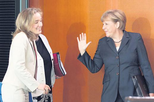 German Chancellor Angela Merkel (right) and Family Minister Kristina Schroeder arrive at a cabinet meeting at the Chancellery in Berlin. Ms Merkel must 'act like a European and recognise and respect other Europeans'.