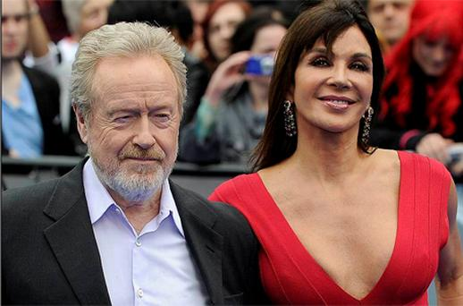 British Producer Ridley Scott (L) and his partner Giannina Facio pose for photographers at the world premiere of 'Prometheus' in London's Leicester Square