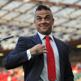 Robbie Williams has been advised to go on tour after his baby is born