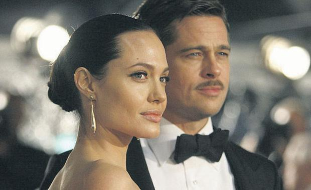 The waiting game: Brad and Angelina will be hoping their long engagement doesn't meet the same sad ending as that of Chris Klein and Katie Holmes