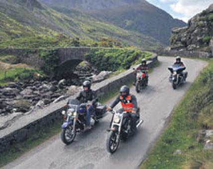 Bikers Michael Thompson, Mark Astle, Mark Ozzie Taylor and Ralph Zirkinitzer ride their Harley-Davidson motorbikes through the Gap of Dunloe in Killarney, Co Kerry, on the opening day of Bikefest yesterday