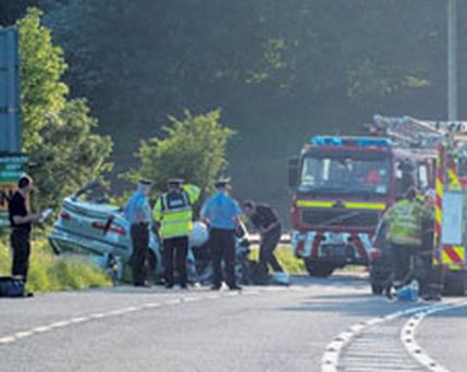 The emergency services working at the scene of the crash on the Cork-Macroom road near Lissarda last night