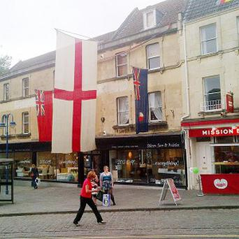 Flags flying outside Silcox Son and Wicks in Bath