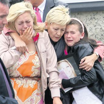 Andrea (18), left, and Hannah (12), right, Furlong with their mother Angie at St Margaret's Church in Curracloe, Co Wexford