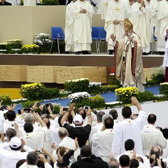 Pope Benedict XVI waves after celebrating a Mass in Bresso (AP)
