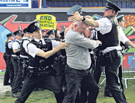 Dissident republicans tussled with PSNI officers near the Peace Bridge in Derry, forcing the re-routing of the relay by about 100 yards