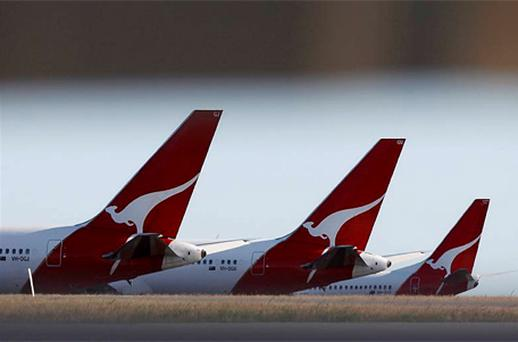 Australia's Qantas Airways warned on June 5, 2012 its underlying profit before tax will fall by up to 90 percent due to deeper losses at its international operations, weak travel demand and soaring fuel costs, sending its shares to a record low. Photo: Reuters