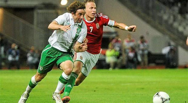 Stephen Hunt in action against Balazs Dzsudzsak of Hungary. Photo: Sportsfile