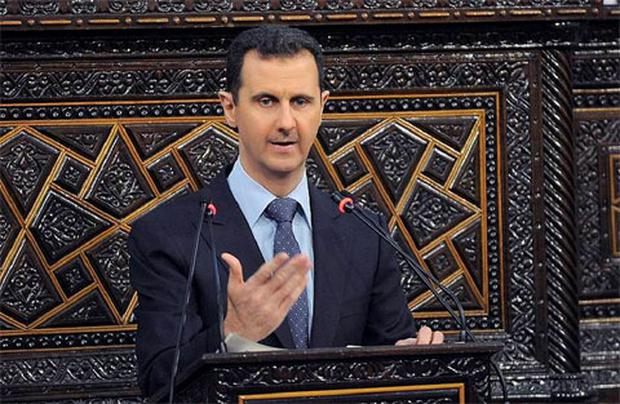Syria's President Bashar al-Assad delivers a speech to Syria's parliament in Damascus.