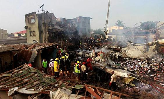 Rescue workers search for bodies of victims of a plane crash at Iju-Ishaga neighbourhood, Lagos. Photo: Reuters