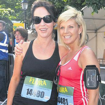 Lisa Duffy with pal Morah Ryan on completing the mini marathon in aid of Irish Autism Action