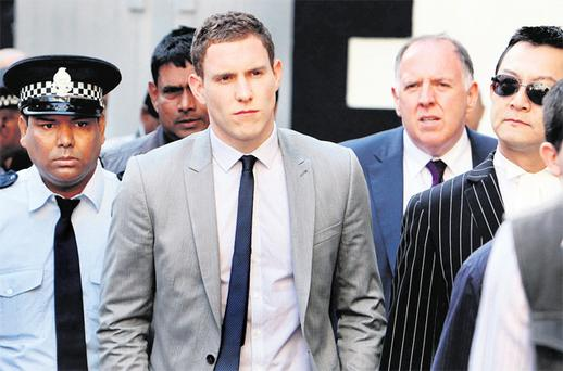 John McAreavey arrives at the Supreme Court in Mauritius yesterday to give evidence at the murder trial of his wife