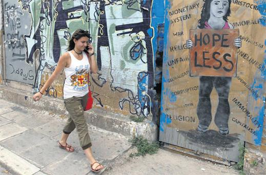 A woman walks down a street in Athens in beleaguered Greece where an election is due on June 17. Photo: Reuters