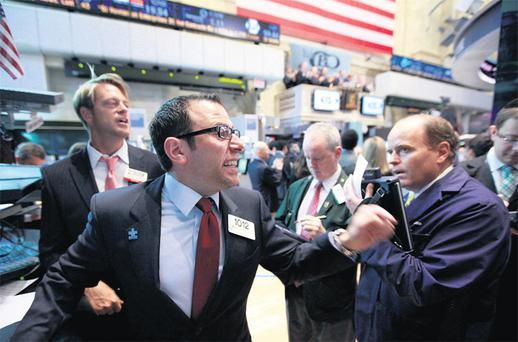 Specialist trader Mike Pistillo gives a price at the opening bell on the floor of the New York Stock Exchange yesterday. Photo: Reuters