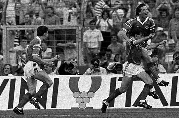 One nil to Ireland. Ray Houghton was mobbed by his team mates...