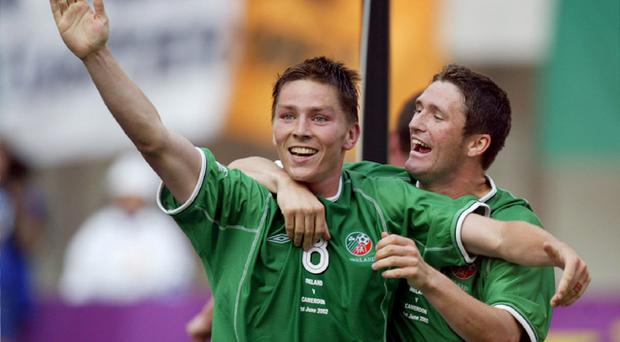 Matt Holland in his playing days with Robbie Keane.