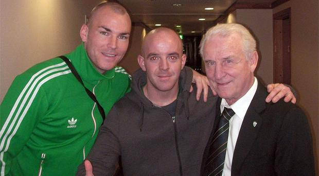 Conor Cunningham (centre) with an unnamed friend (left) and Ireland manager Giovanni Trapattoni. Photo: PA