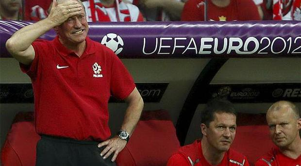 Poland's coach Franciszek Smuda (L) reacts during their Euro 2012 Group A match against Greece. Photo: Reuters