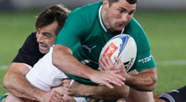 Ireland's Rob Kearney (R) is tackled by All Black's Conrad Smith during their test match at Eden Park in Auckland, June 9, 2012. Photo: REUTERS