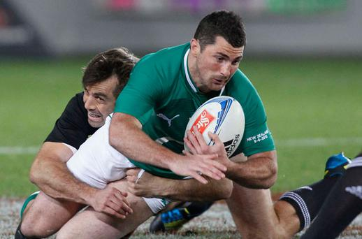 Ireland's Rob Kearney (R) is tackled by All Black's Conrad Smith