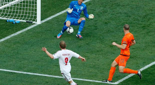 Michael Krohn-Dehli scored the only goal of the game as Denmark shocked highly-fancied Holland. Photo: Reuters