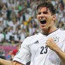 Mario Gomez scored a magnificent header as Germany battled their way past Portugal. Photo: Reuters