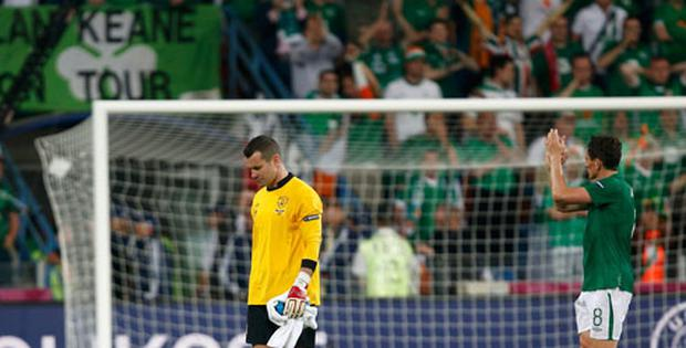 Ireland's goalkeeper Shay Given (L) and Keith Andrews leave the pitch after their lost Group C Euro 2012 soccer match against Croatia. Photo: Reuters