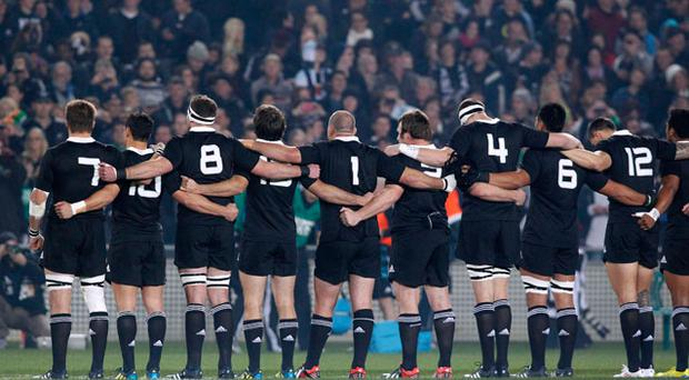 The All Blacks link arms as they sing the national anthem. Photo: Reuters