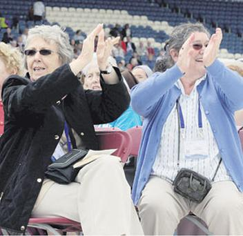 Pilgrims applaud during the opening ceremony at the 50th International Eucharistic Congress, which opened at the RDS yesterday