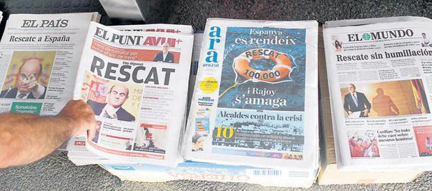 Spanish newspapers show news of the bailout request