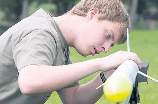 Joe Murphy, from Co Donegal, gets one of his rockets ready as he takes part in the Irish Rocketry society, which was held in Tuam