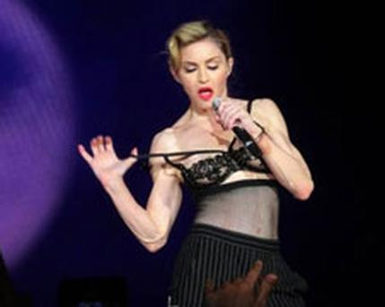 Madonna courts controversy yet again as she exposes herself on stage