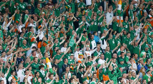 Ireland supporters cheer their team off the pitch. Photo: Reuters
