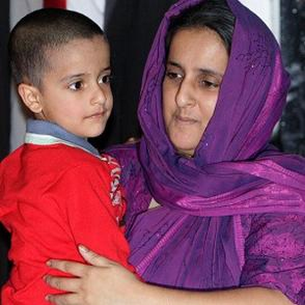 Five-year-old Sahil Saeed at home in Oldham, with his mother Akila Naqqash, after his release from kidnappers in Pakistan