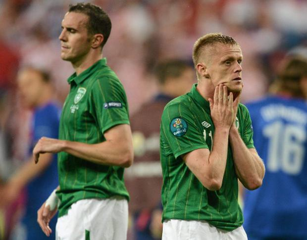 A dejected Damien Duff, right, and John O'Shea, Republic of Ireland, after the game. EURO2012, Group C, Republic of Ireland v Croatia, Municipal Stadium Poznan, Poznan, Poland. Picture credit: David Maher / SPORTSFILE